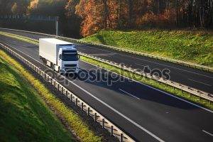 depositphotos_65939737-Truck-on-the-road